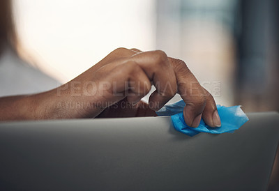 Buy stock photo Closeup shot of an unrecognisable businesswoman cleaning a laptop in an office