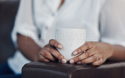 Buy stock photo Closeup shot of an unrecognisable businesswoman drinking coffee while taking a break in an office