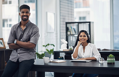 Buy stock photo Portrait of a young businesswoman sitting in an office with her colleague in the foreground