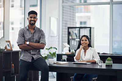 Buy stock photo Portrait of a young businessman in an office with his colleague in the background