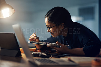 Buy stock photo Shot of a young technician using a screwdriver to repair computer hardware