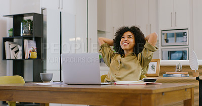 Buy stock photo Shot of a young woman taking a break while working from home