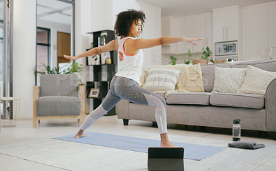 Buy stock photo Shot of a young woman using a digital tablet while practicing yoga at home