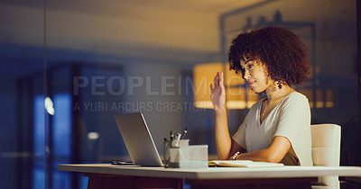 Buy stock photo Shot of a young woman using a laptop during a late night video conference in a modern office