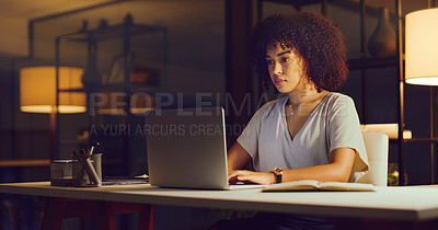 Buy stock photo Shot of young businesswoman using a laptop during a late night in a modern office