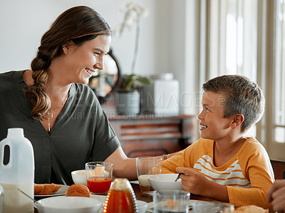 Buy stock photo Cropped shot of a woman and her young son having breakfast together at home