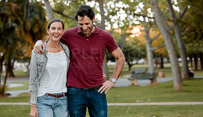 Buy stock photo Cropped shot of an affectionate couple taking a walk through the park