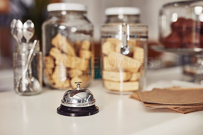 Buy stock photo Shot of a service bell on a counter in a cafe