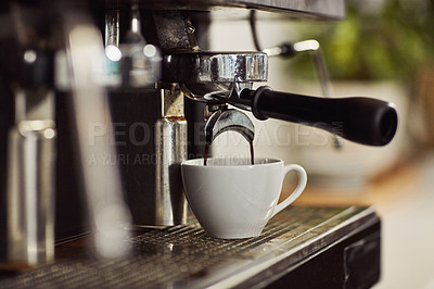 Buy stock photo Cropped shot of freshly brewed coffee dripping into a cup