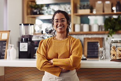 Buy stock photo Portrait of a confident young woman working in a coffeeshop