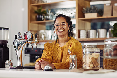 Buy stock photo Portrait of a confident young woman standing behind the counter in a cafe