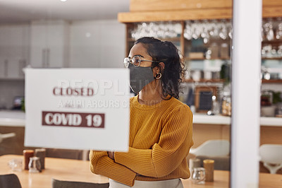 Buy stock photo Shot of a cafe owner hanging up a sign reading