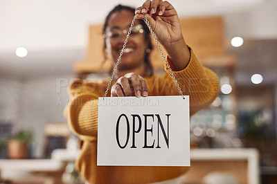 Buy stock photo Shot of a cafe owner hanging up an open sign