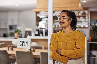 Buy stock photo Shot of a cafe owner standing next to an open sign