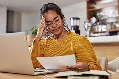 Buy stock photo Shot of a cafe owner looking stressed while looking at paperwork