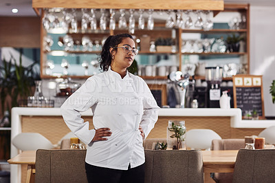 Buy stock photo Cropped shot of a woman wearing a chef's jacket while standing in a cafe