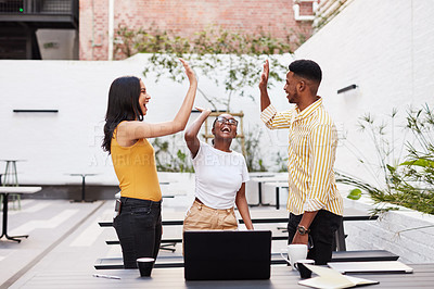 Buy stock photo Shot of a group of young businesspeople celebrating during a meeting outdoors