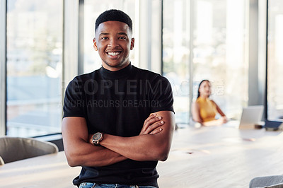 Buy stock photo Portrait of a confident young businessman in the boardroom of a modern office with his colleagues in the background