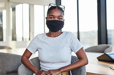 Buy stock photo Portrait of a confident masked young businesswoman in the boardroom of a modern office