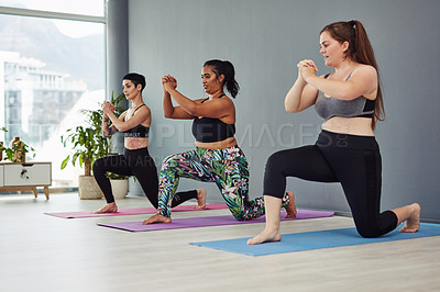 Buy stock photo Shot of a group of young women doing lunges in a gym