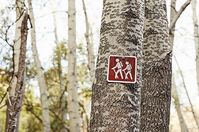 Buy stock photo Shot of a sign on a tree along a hiking trail in nature