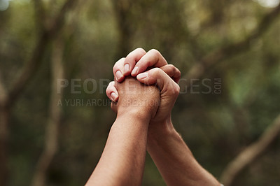 Buy stock photo Cropped shot of two women holding hands out in nature