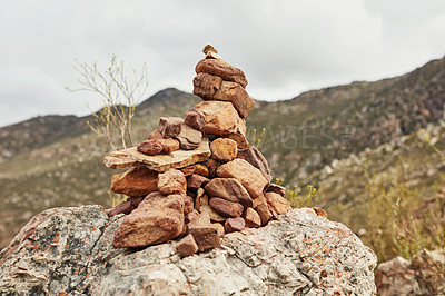 Buy stock photo Shot of a pile of rocks on top of a mountain along a hiking trail