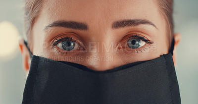 Buy stock photo Portrait of a young woman wearing a black face mask