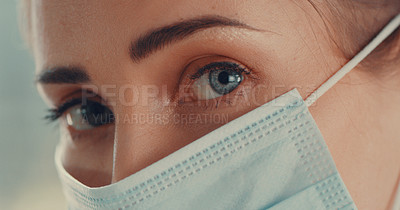 Buy stock photo Portrait of a young woman wearing a medical face mask