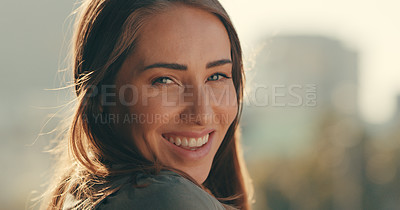 Buy stock photo Cropped shot of a beautiful young woman standing outside