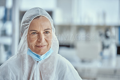 Buy stock photo Shot of a mature scientist looking thoughtful while working in a laboratory