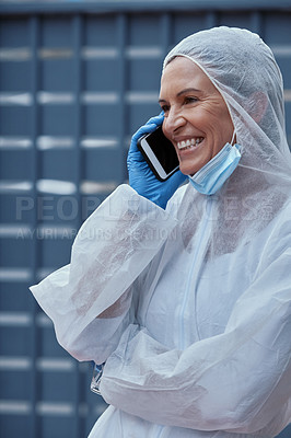 Buy stock photo Shot of a mature scientist using a smartphone during an outbreak in the city