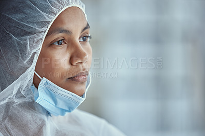 Buy stock photo Shot of a young scientist looking thoughtful while working in a laboratory