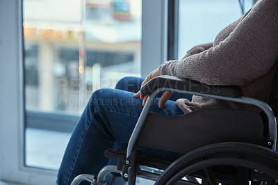 Buy stock photo Cropped shot of an unrecognisable senior woman sitting in a wheelchair