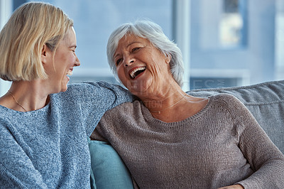 Buy stock photo Shot of a senior woman spending time with her daughter at home
