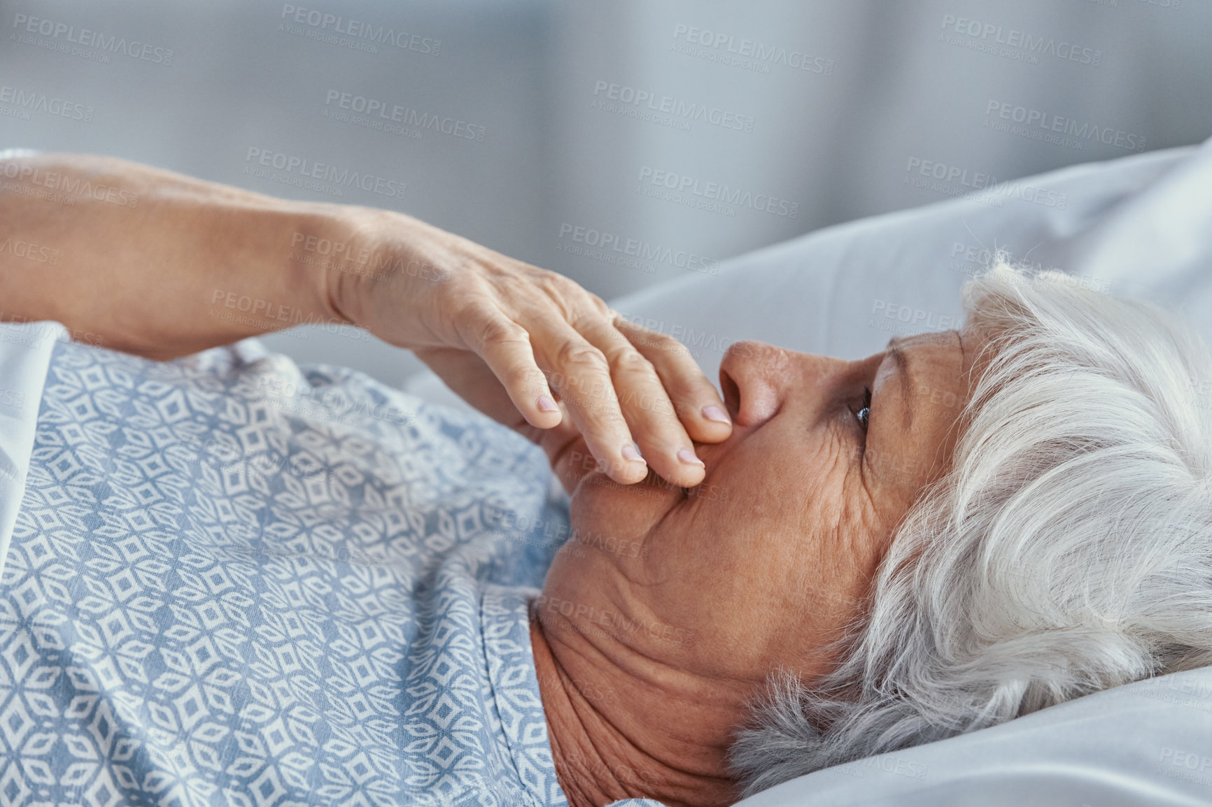 Buy stock photo Shot of a senior woman lying in a hospital bed and coughing