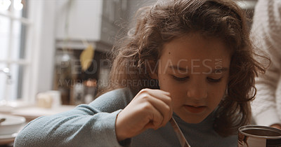 Buy stock photo Cropped shot of a little girl making herself hot chocolate at home