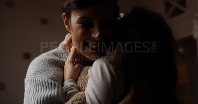 Buy stock photo Cropped shot of a woman and her young daughter hugging in the bedroom at home