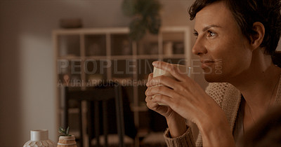 Buy stock photo Shot of a woman drinking coffee while relaxing at home