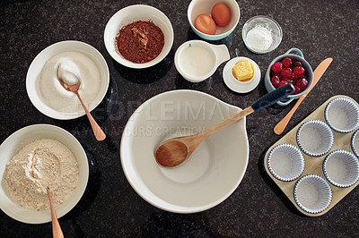 Buy stock photo High angle shot of various baking items on a kitchen counter at home
