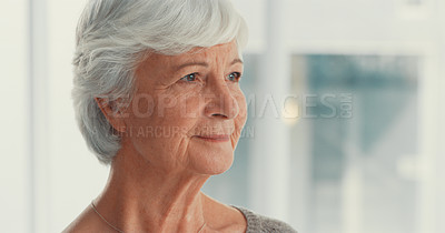 Buy stock photo Shot of a senior woman looking thoughtful in a nursing home
