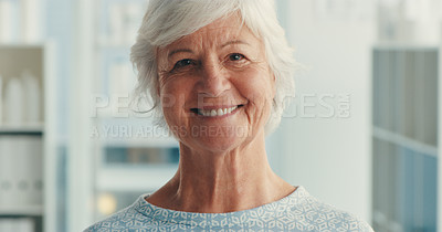 Buy stock photo Portrait of a senior woman wearing a hospital gown in a hospital