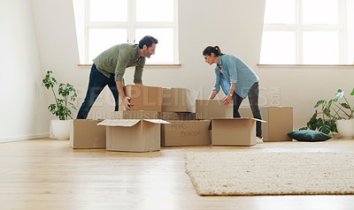 Buy stock photo Shot of a couple moving into their new home