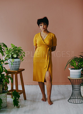 Buy stock photo Portrait of a young woman standing with plants around her at home
