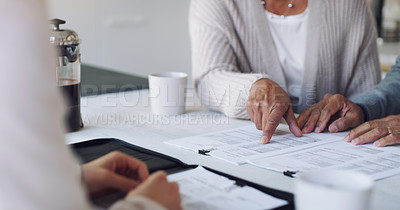 Buy stock photo Cropped shot of a senior couple meeting with a consultant to discuss paperwork at home