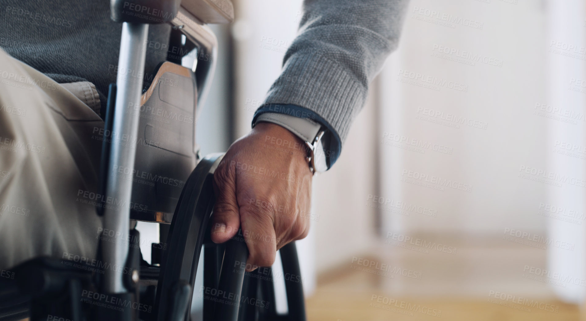 Buy stock photo Cropped shot of an unrecognisable senior man using a wheelchair at home