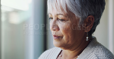 Buy stock photo Shot of a senior woman looking sad at home