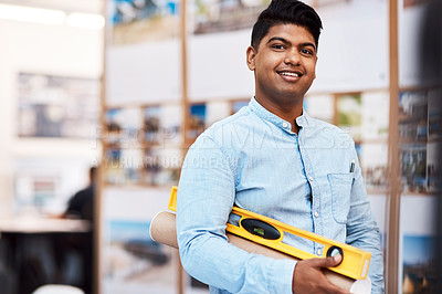Buy stock photo Portrait of a young man holding a spirit level in a modern office