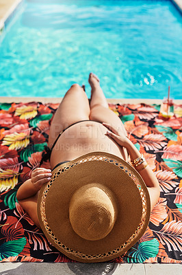Buy stock photo Shot of a pregnant woman wearing a bikini while relaxing by the pool