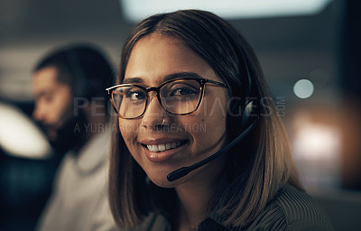 Buy stock photo Portrait of a call centre agent working in an office at night